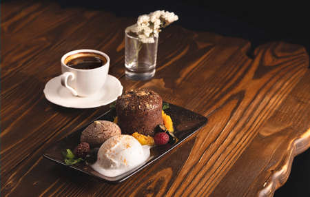 Nicely served chocolate fondant with ice cream. Food styling