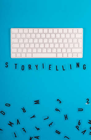 Tell stories to sell. Storytelling concept layout on blue