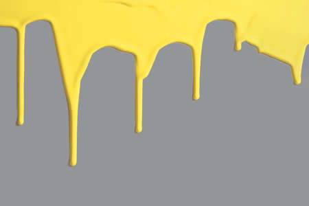 Yellow paint on gray background color of the year 2021