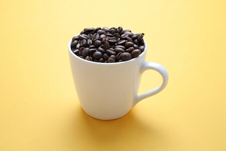 Coffee Beans and Cups .yellow background