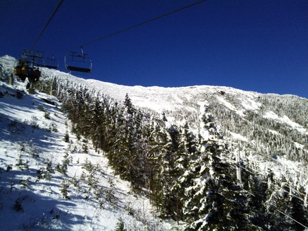 Ski Lift on Snow Covered Mountain photo