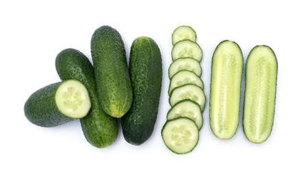 Group of fresh little cucumber. Mix of whole, chopped and sliced cucumbers isolated on wite background.