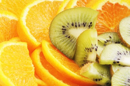 Oranges and kiwi fruit close-up, may be for background  photo