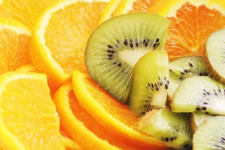 Oranges and kiwi fruit close-up, may be for background  photo