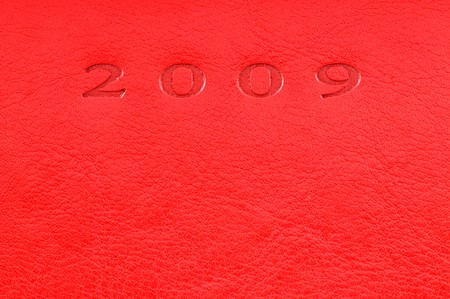 red leather texture: Red leatherette texture with stamped digits for background Stock Photo