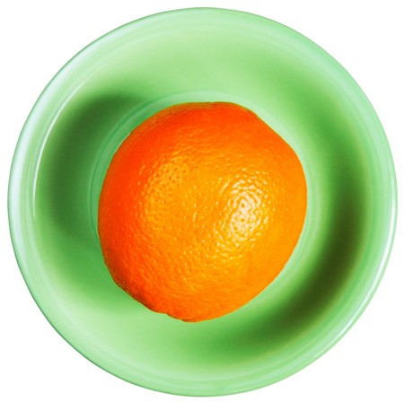 bove: Ripe orange on green plate bove view isolated on whitea