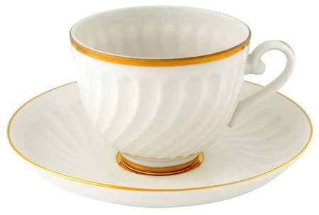 Empty porcelain cup and saucer isolated on white
