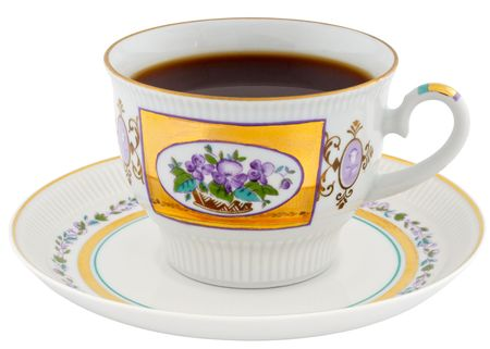 Porcelain cup of tea and saucer isolated on white