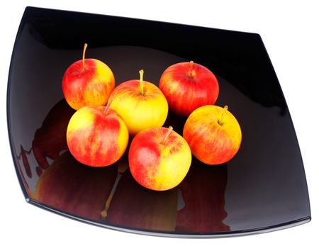 rennet: Red with yellow ripe apples on black plate isolated on white