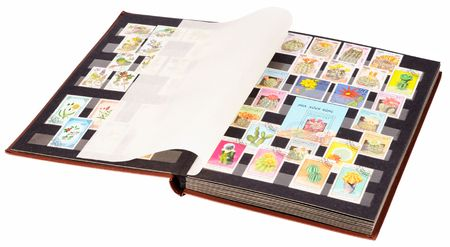 Open postage stamp album isolated on the white
