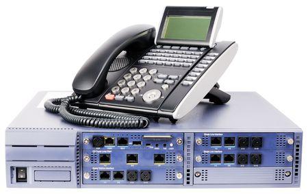 telephone: Sistema de conmutaci�n de tel�fono de escritorio y tel�fono digital conjunto aislados en blanco Foto de archivo