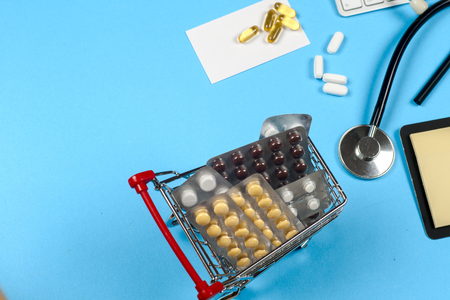retail therapy: Medical report with pills and a stethoscope. Stock Photo