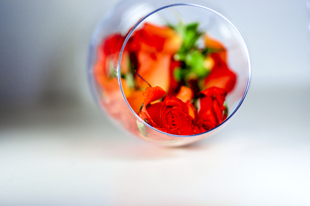 sweetest: Glass vase filled with red rose petals. Aromatherapy concept.