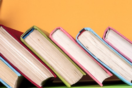 Set of colored books on bright colorful background. Back to school