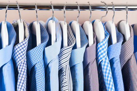 clothing shop: Cloth Hangers with Shirts. Mens clothes