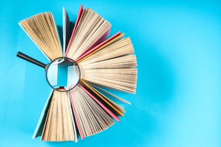 Top view of bright colorful hardback books in a circle. Reklamní fotografie - 76346003