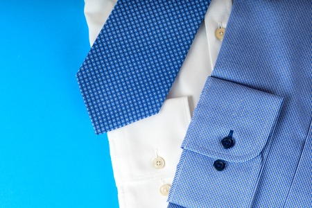 stuff: Stack of blue and white shirt closeup on a light background. Stock Photo