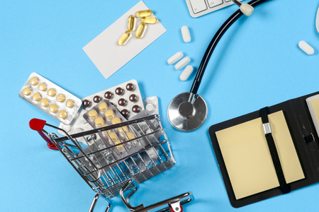 Medical report with pills and a stethoscope. Stock Photo
