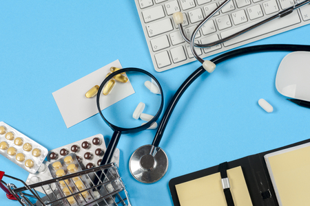 healthful: Medical report with pills and a stethoscope. Stock Photo