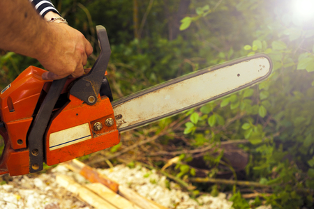 Sawing wood with a chainsaw. carpenter working Reklamní fotografie