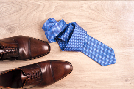 sleeve: Mens accessories mens shoes, tie on a wooden background. Classic mens accessories. Top view Stock Photo