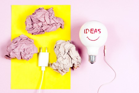 great idea concept with crumpled colorful paper and light bulb on light background Stock Photo