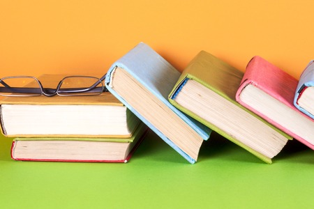 Set of books in the library. Knowledge, Science. Toned image. Stock Photo