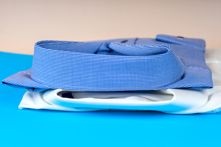 Stack of blue and white shirt closeup on a light background. Stock Photo