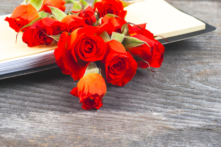 red roses on wooden board, Valentines Day background, mothers Day.