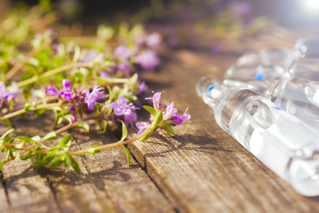 Alternative Medicine.Thyme and medical ampoules. Essential oils 스톡 콘텐츠