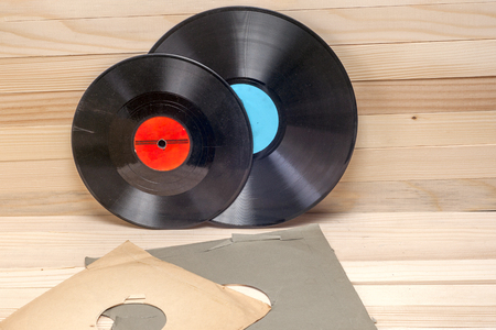 Vinyl record in front of a collection of albums, vintage process. Copy space for text Banco de Imagens