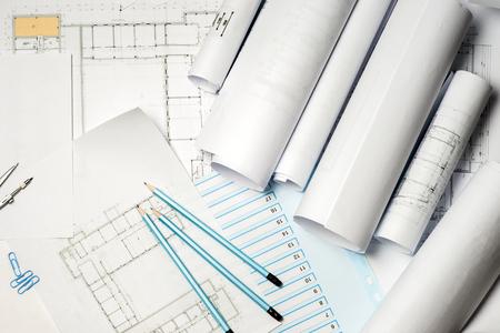 Architect working on blueprint.