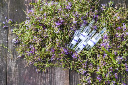 Alternative Medicine.Thyme and medical ampoules. Essential oils 写真素材 - 130718099