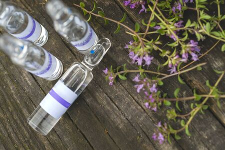 Alternative Medicine.Thyme and medical ampoules. Essential oils 写真素材 - 130718240