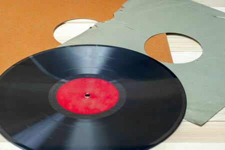 Vinyl record in front of a collection of albums, vintage process. Copy space for text 写真素材 - 130718269