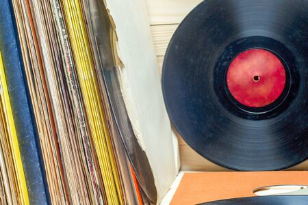 Vinyl record in front of a collection of albums, vintage process. Copy space for text 写真素材 - 130718947