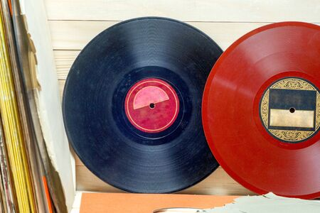 Vinyl record in front of a collection of albums, vintage process. Copy space for text 写真素材 - 130719141