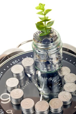 coins with plant and clock, isolated on white background. savings concept 写真素材 - 130717831