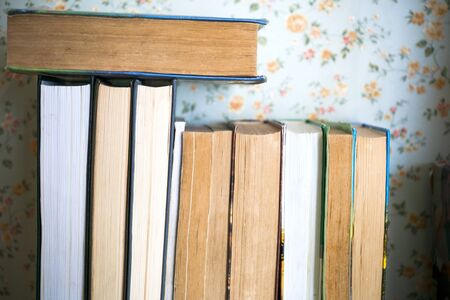 Open book, hardback books on bright colorful background. 写真素材 - 135193347