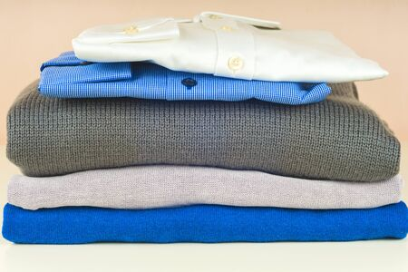 Stack of blue and white shirt closeup on a light background. 写真素材 - 135193370