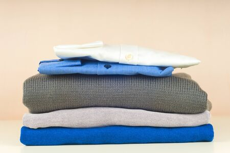 Stack of blue and white shirt closeup on a light background. 写真素材 - 135193600