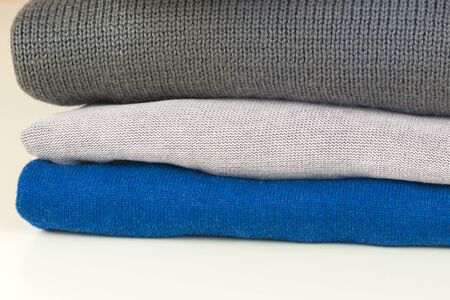 stack of clothing isolated on white 写真素材 - 136969974