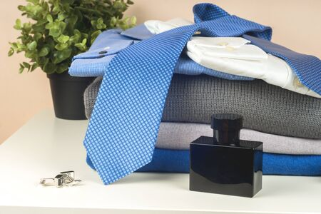 Stack of blue and white shirt closeup on a light background. 写真素材 - 136969980
