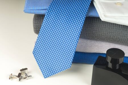 Stack of blue and white shirt closeup on a light background. 写真素材