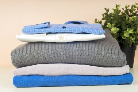 Stack of blue and white shirt closeup on a light background. 写真素材 - 136969989