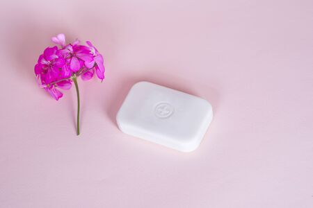 Soap bar in foam with copy space in center isolated on bright pink background. Reklamní fotografie