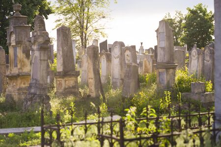 The Old Jewish cemetery at colorful sunset sky, Chernivtsi Ukraine. Reklamní fotografie - 147409602