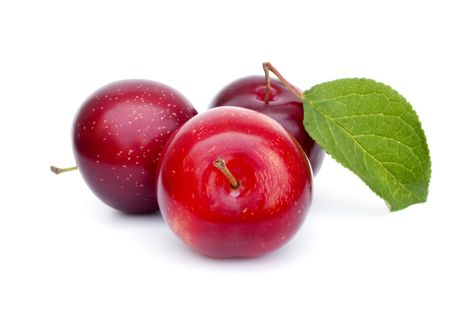 plum: Three fresh ripe plums with leaf Stock Photo