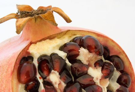 Cutted pomegranate fruite on white background photo