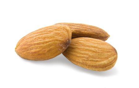 Three almonds isolated on white background photo